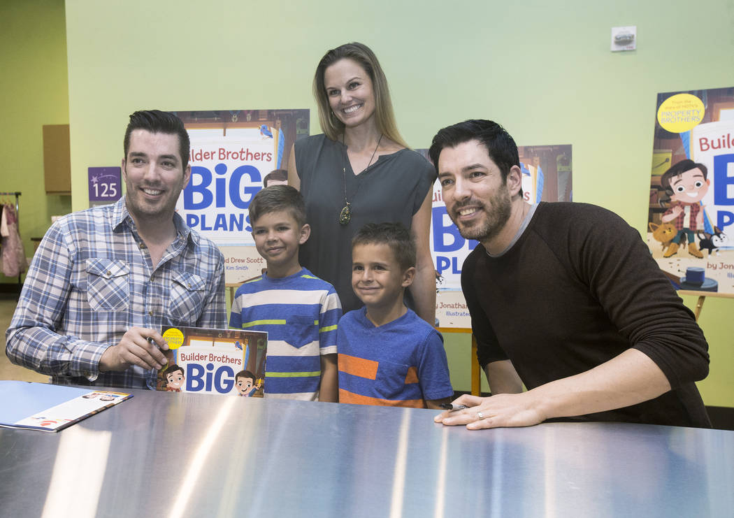 """Jonathan, left, and Drew Scott of """"Property Brothers"""" take a photo with Lyndsey Thomas and her sons Alexander, left, and Gabriel during a book signing at Discovery Children's Museum on M ..."""