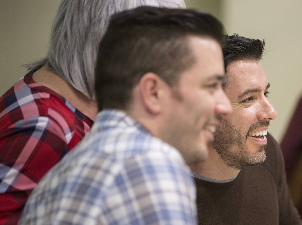 """Jonathan, left, and Drew Scott of """"Property Brothers"""" take photos with fans during a book signing at Discovery Children's Museum on Monday, Oct. 8, 2018, in Las Vegas. Benjamin Hager Las ..."""