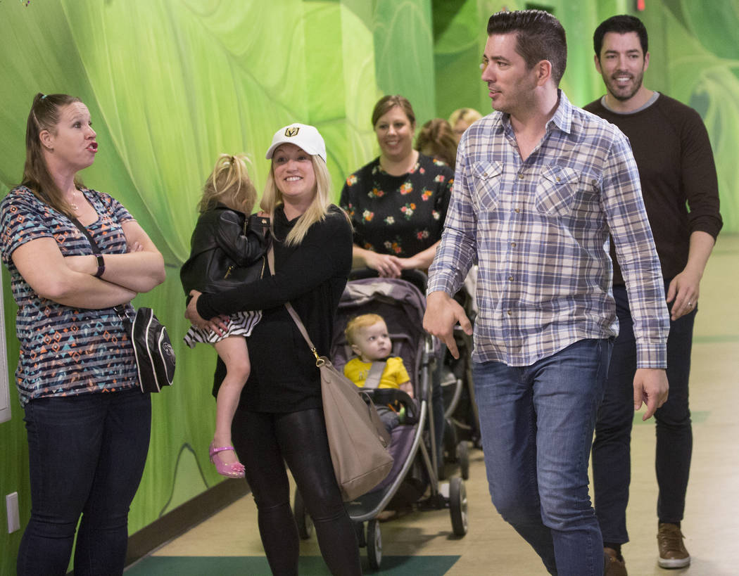 """Jonathan, middle/right, and Drew Scott of """"Property Brothers"""" surprise fans during a book signing at Discovery Children's Museum on Monday, Oct. 8, 2018, in Las Vegas. Benjamin Hager Las ..."""