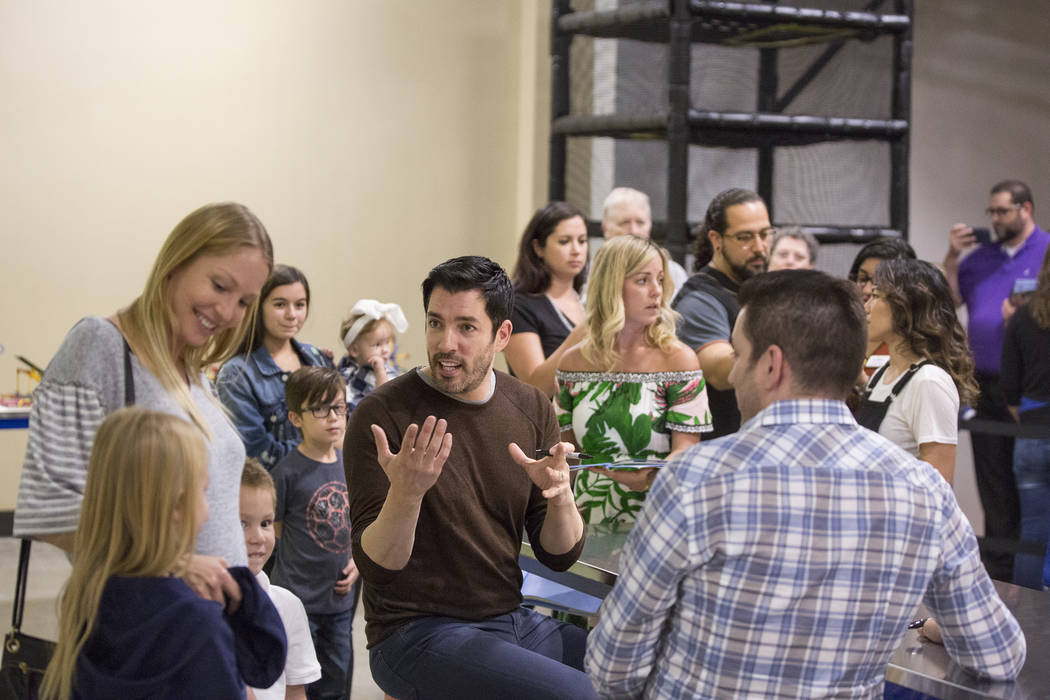 """Drew Scott, middle, of """"Property Brothers,"""" talks with fans during a book signing at Discovery Children's Museum on Monday, Oct. 8, 2018, in Las Vegas. Benjamin Hager Las Vegas Review-Jo ..."""