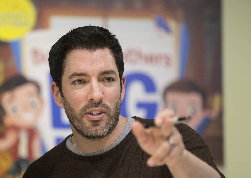 """Drew Scott of """"Property Brothers"""" points at fans during a book signing at Discovery Children's Museum on Monday, Oct. 8, 2018, in Las Vegas. Benjamin Hager Las Vegas Review-Journal @benj ..."""