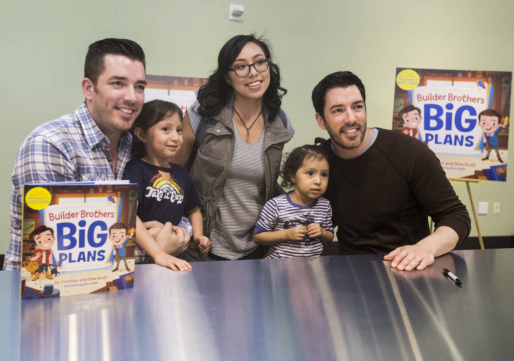 """Jonathan, left, and Drew Scott of """"Property Brothers"""" take a photo with Raquel Lopez, middle, and her daughters Mila, left, and Jazlyn, during a book signing at Discovery Children's Muse ..."""