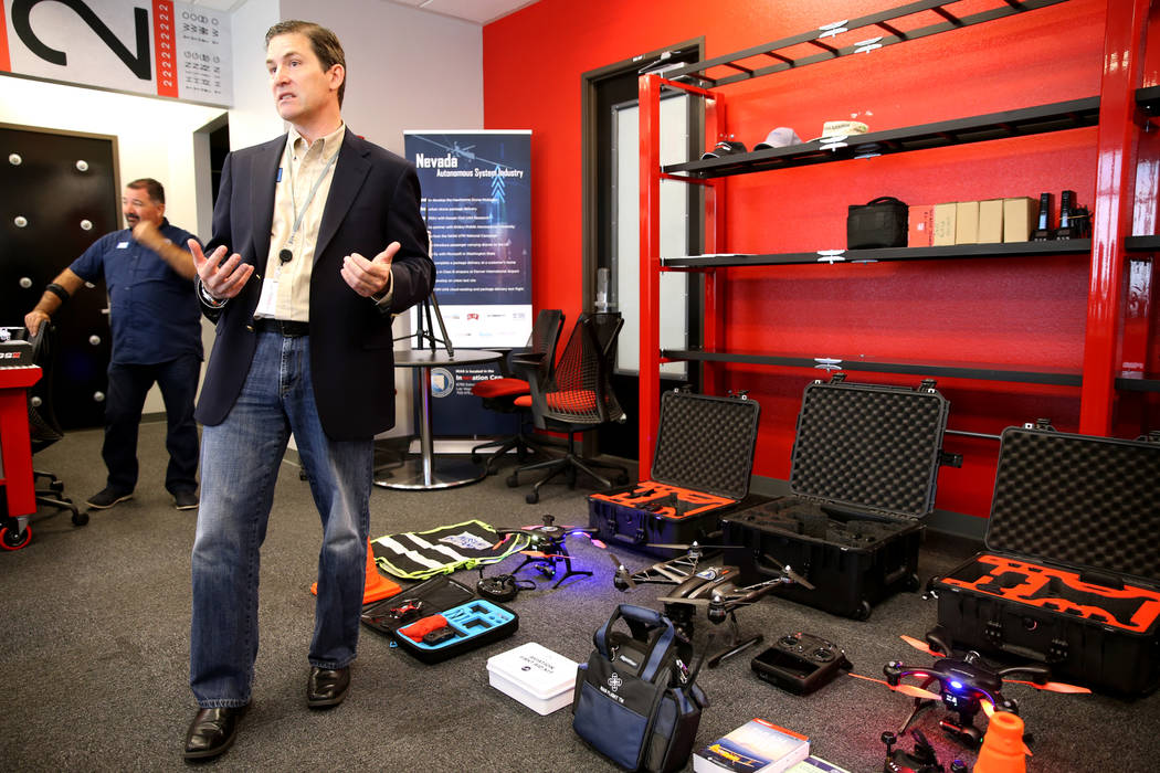 Dr. Chris Walach, senior director of Nevada Institute for Autonomous Systems, shows a variety of drones at NIAS's new Nevada Drone Center of Excellence for Public Safety, located inside the Switch ...