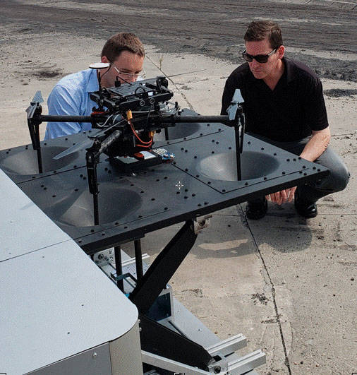 Chris Walach, executive and senior director of the Nevada Institute for Autonomous Systems, right, examines a drone with Krzysztof Kazmierczak of JSW Innovation during NIAS's trip to Poland. (JSW ...