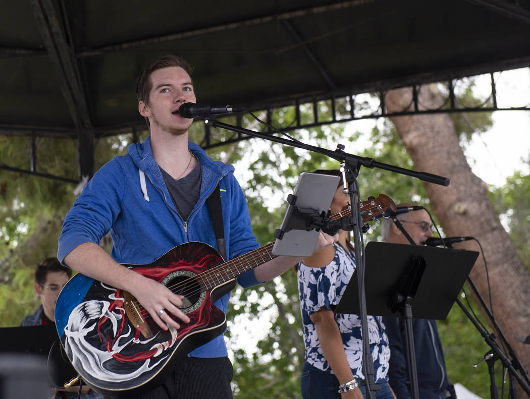 Teddy Martin of Boulder City sings as he performs with fellow Christian Center Church members at the annual Art in the Park event in Boulder City, Sunday, Oct. 7, 2018. Caroline Brehman/Las Vegas ...