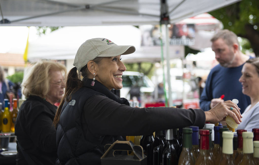 Owner of California Balsamic Ethel Klimes of Ukiah, California talks with customers at the annual Art in the Park event in Boulder City, Sunday, Oct. 7, 2018. Caroline Brehman/Las Vegas Review-Jou ...