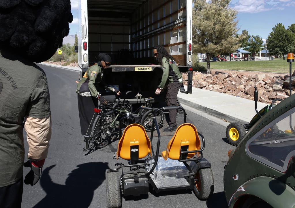 Retired U.S. Air Force Senior Airmen Kelley Guidry, right, and her husband Peter load a tricycle into a truck at Patriot Park on Monday, Oct. 8, 2018, in Las Vegas. The Kelley's formed the nonprof ...