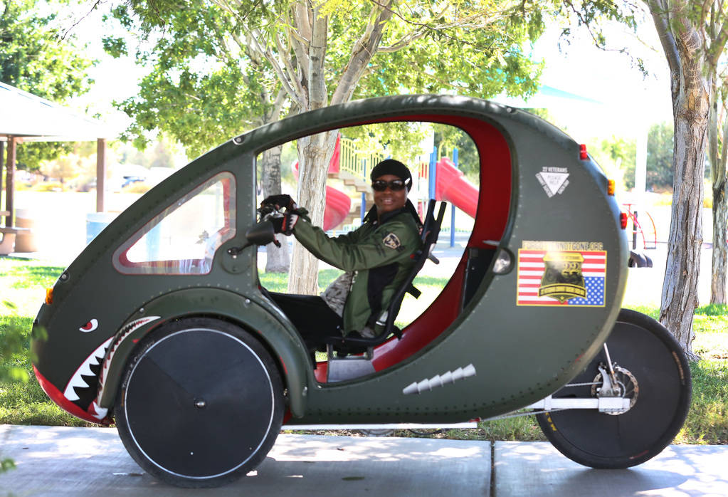 A retired U.S. Air Force Senior Airman Kelley Guidry, CEO and founder of the nonprofit group Forgotten Not Gone, rides her ELF, a solar-powered bike-car, at Patriot Park on Monday, Oct. 8, 2018, i ...
