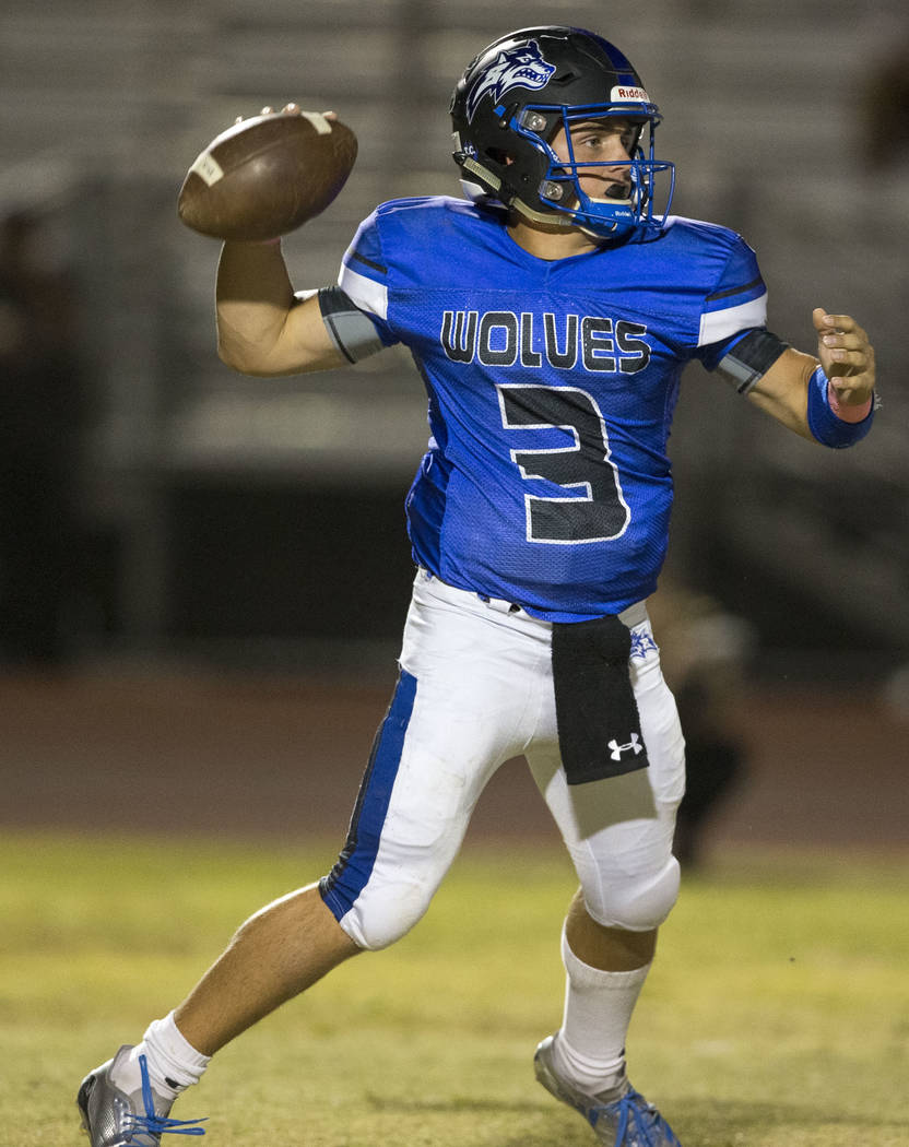 Basic quarterback Paul Myro IV (3) throws a pass against Foothill during the first half of a varsity football game at Basic High School in Henderson on Friday, Oct. 5, 2018. Richard Brian Las Vega ...