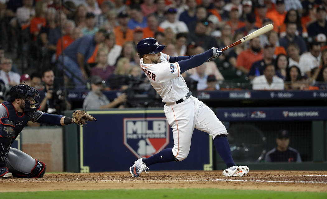 2c7c1edd0 Houston Astros  George Springer celebrates hits a solo home run against  Cleveland Indians pitcher Corey Kluber during fifth inning in Game 1 of an  American ...