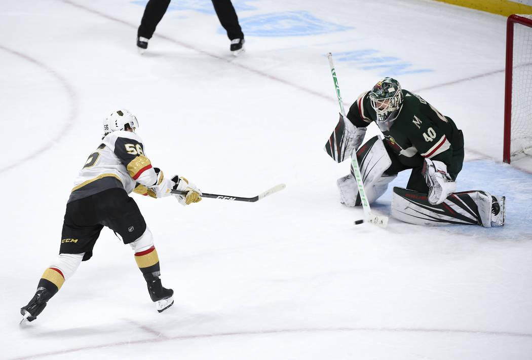 Vegas Golden Knights left wing Erik Haula (56) gets this shot past Minnesota Wild goalie Devan Dubnyk to win an NHL hockey game in a shootout Saturday, Oct. 6, 2018, in St. Paul, Minn. (AP Photo/C ...