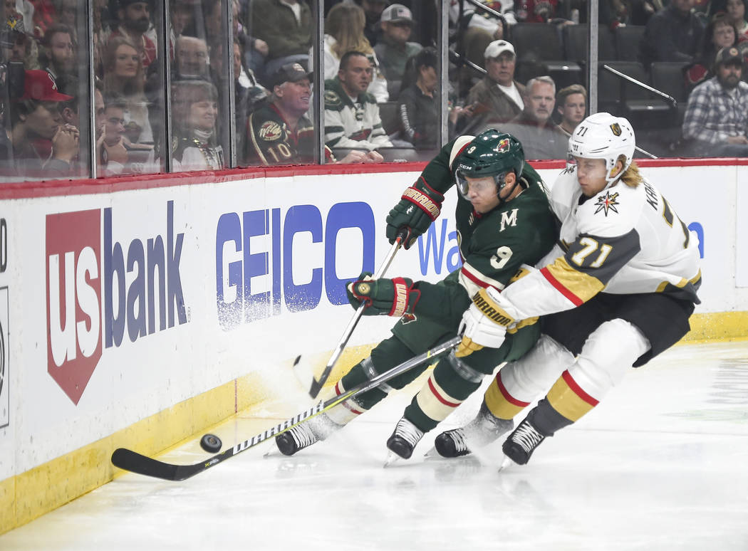 Minnesota Wild center Mikko Koivu (9) and Vegas Golden Knights center William Karlsson (71) battle for the puck in the first period during an NHL hockey game Saturday, Oct. 6, 2018, in St. Paul, M ...