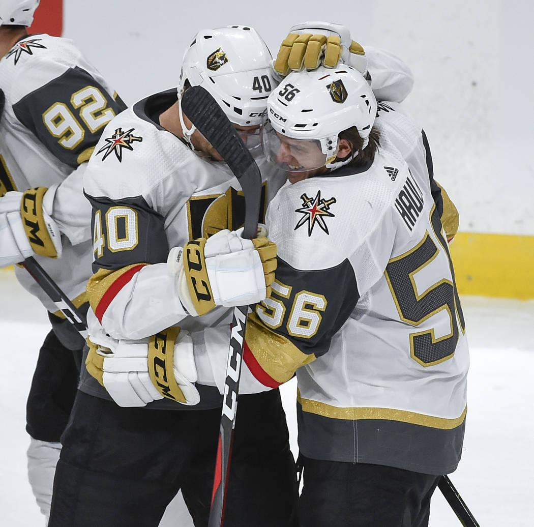 Vegas Golden Knights left wing Erik Haula (56) celebrates with center Ryan Carpenter (40) after scoring an NHL hockey game winning goal in a shootout Saturday, Oct. 6, 2018, in St. Paul, Minn. (AP ...
