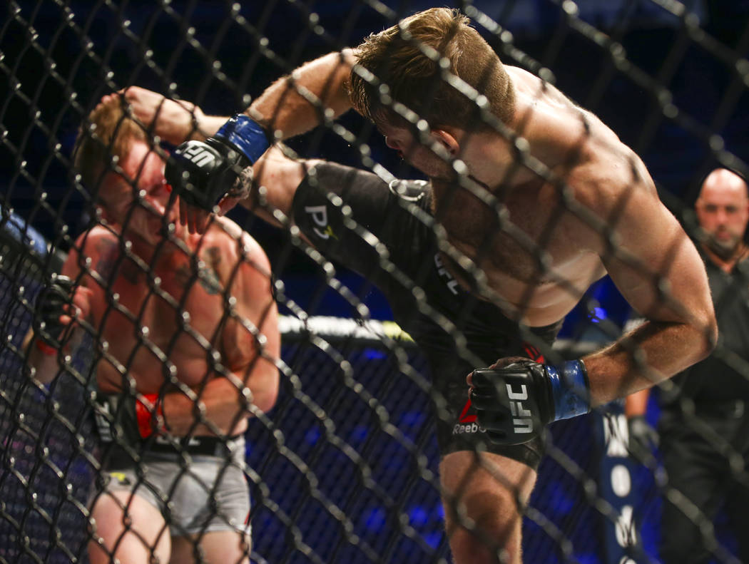 Nik Lentz lands a kick against Gray Maynard leading to a technical knockout during their lightweight bout at UFC 229 at T-Mobile Arena in Las Vegas on Saturday, Oct. 6, 2018. Chase Stevens Las Veg ...