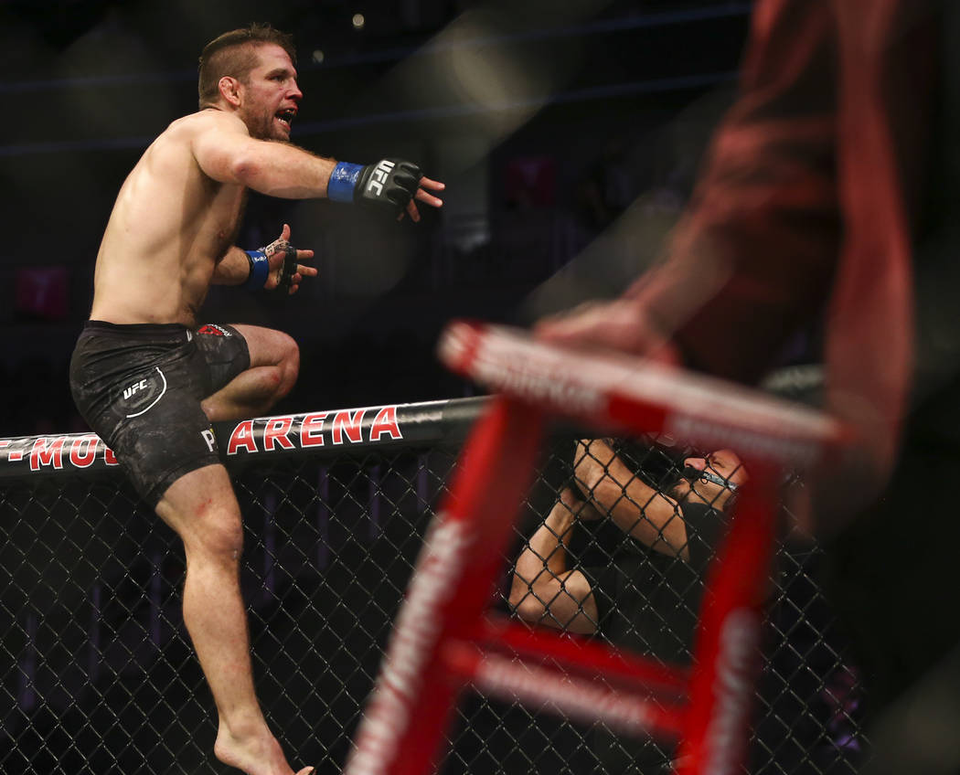 Nik Lentz celebrates his second-round technical knockout over Gray Maynard, not pictured, in their lightweight bout at UFC 229 at T-Mobile Arena in Las Vegas on Saturday, Oct. 6, 2018. Chase Steve ...