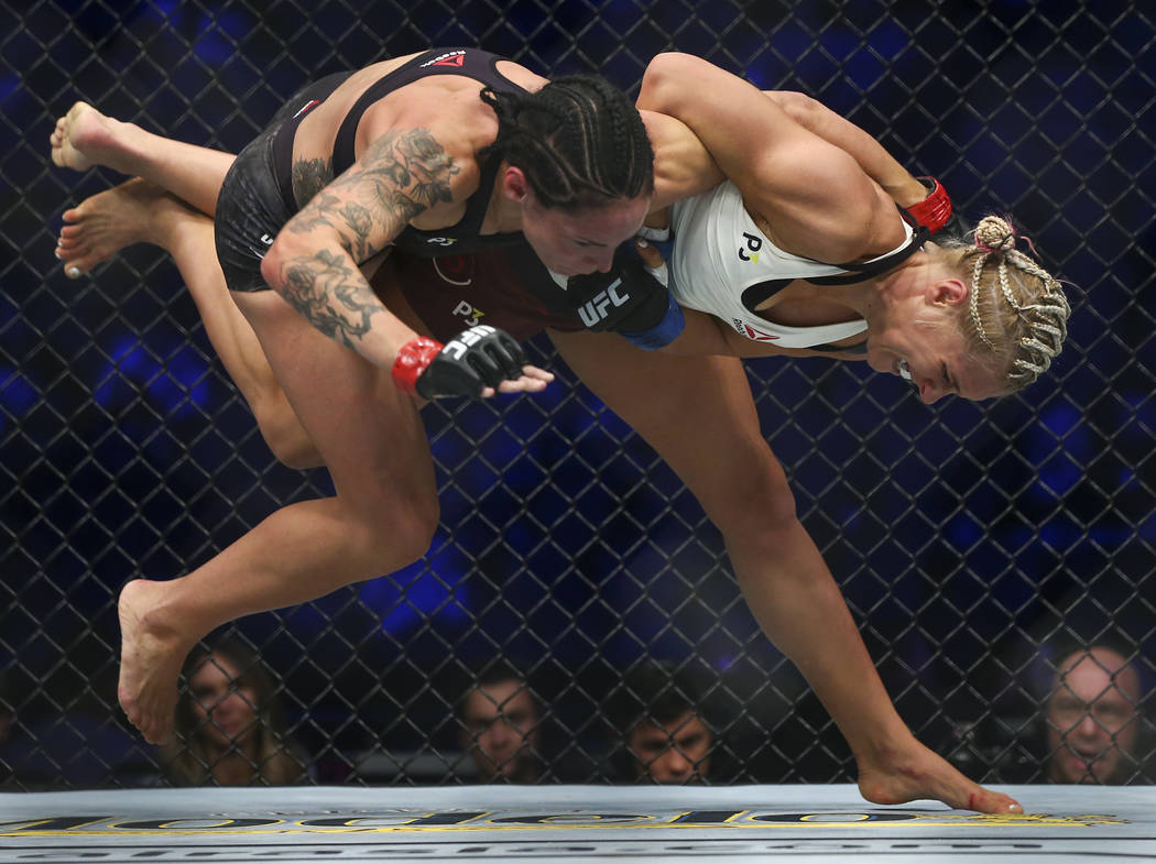 Yana Kunitskaya, right, takes Lina Lansberg to the mat during their bantamweight bout at UFC 229 at T-Mobile Arena in Las Vegas on Saturday, Oct. 6, 2018. Chase Stevens Las Vegas Review-Journal @c ...