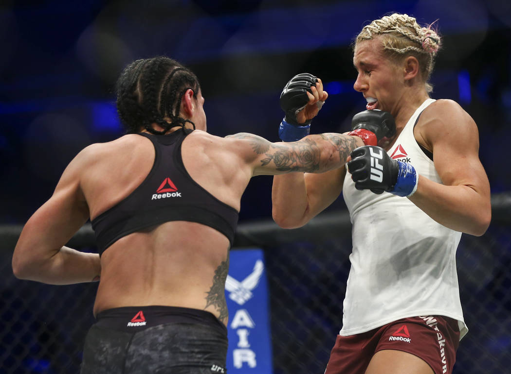 Lina Lansberg, left, fights Yana Kunitskaya during their bantamweight bout at UFC 229 at T-Mobile Arena in Las Vegas on Saturday, Oct. 6, 2018. Chase Stevens Las Vegas Review-Journal @csstevensphoto