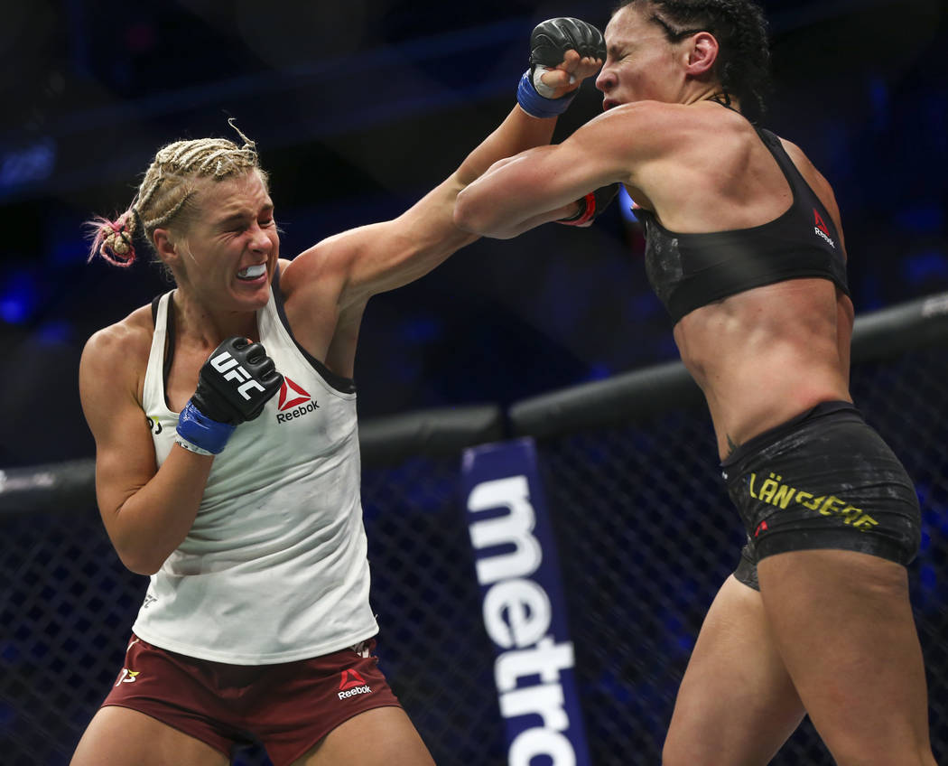 Lina Lansberg, right, takes a hit from Yana Kunitskaya during their bantamweight bout at UFC 229 at T-Mobile Arena in Las Vegas on Saturday, Oct. 6, 2018. Chase Stevens Las Vegas Review-Journal @c ...