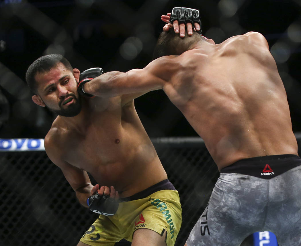 Jussier Formiga, left, fights Sergio Pettis during their flyweight bout at UFC 229 at T-Mobile Arena in Las Vegas on Saturday, Oct. 6, 2018. Chase Stevens Las Vegas Review-Journal @csstevensphoto