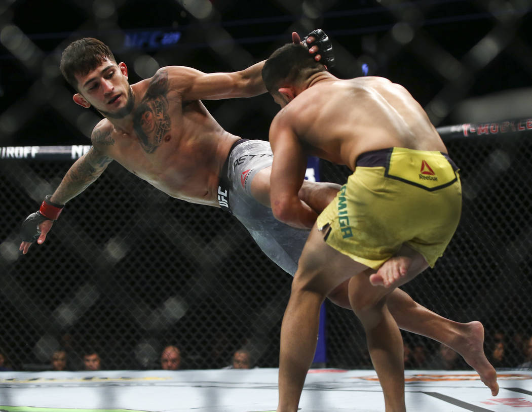Jussier Formiga, right, brings Sergio Pettis to the mat during their flyweight bout at UFC 229 at T-Mobile Arena in Las Vegas on Saturday, Oct. 6, 2018. Chase Stevens Las Vegas Review-Journal @css ...