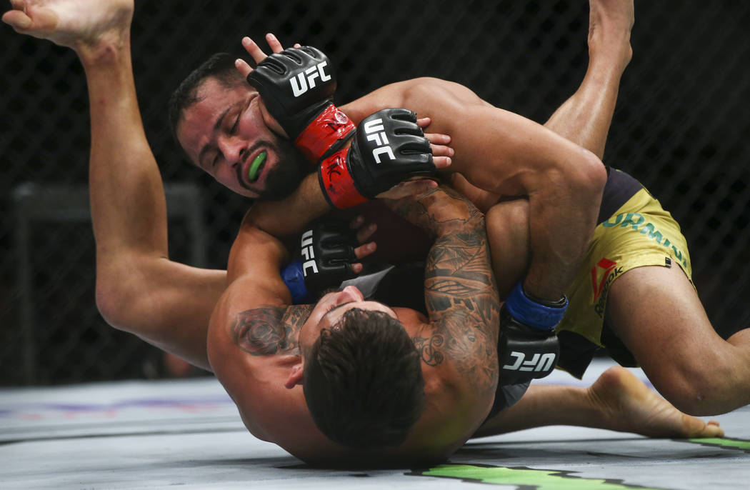 Jussier Formiga, above, fights Sergio Pettis during their flyweight bout at UFC 229 at T-Mobile Arena in Las Vegas on Saturday, Oct. 6, 2018. Chase Stevens Las Vegas Review-Journal @csstevensphoto