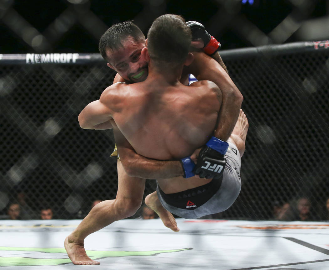 Jussier Formiga, above, takes Sergio Pettis to the mat during their flyweight bout at UFC 229 at T-Mobile Arena in Las Vegas on Saturday, Oct. 6, 2018. Chase Stevens Las Vegas Review-Journal @csst ...