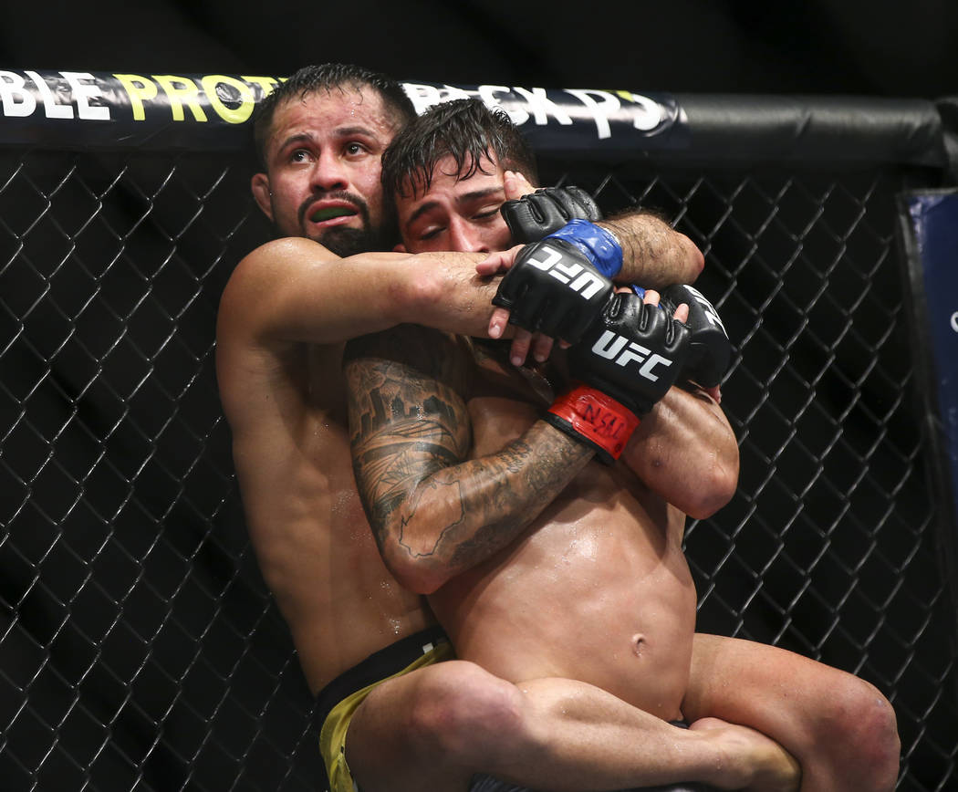 Jussier Formiga, left, grapples with Sergio Pettis against the octagon cage during their flyweight bout at UFC 229 at T-Mobile Arena in Las Vegas on Saturday, Oct. 6, 2018. Chase Stevens Las Vegas ...