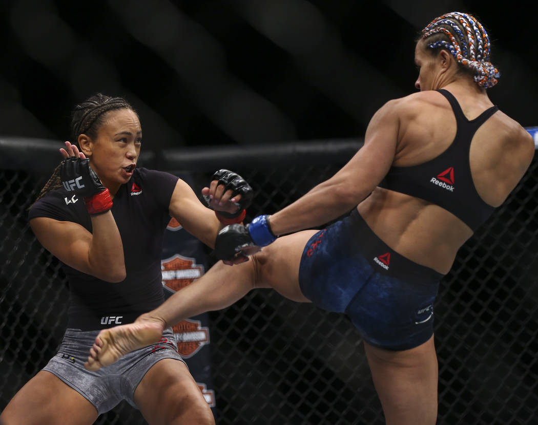 Michelle Waterson, left, fights Felice Herrig during their strawweight bout at UFC 229 at T-Mobile Arena in Las Vegas on Saturday, Oct. 6, 2018. Waterson won via unanimous decision. Chase Stevens ...