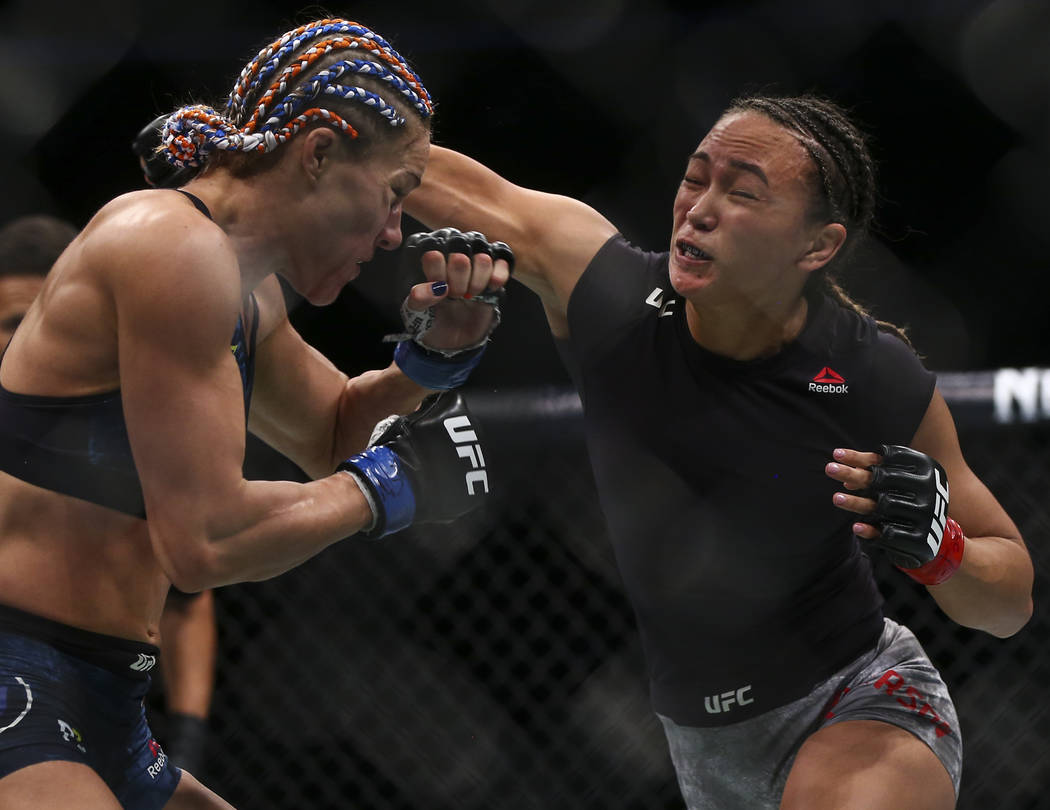 Michelle Waterson, right, fights Felice Herrig during their strawweight bout at UFC 229 at T-Mobile Arena in Las Vegas on Saturday, Oct. 6, 2018. Waterson won via unanimous decision. Chase Stevens ...