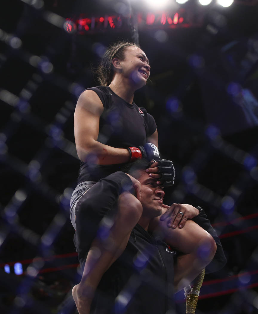 Michelle Waterson celebrates her unanimous decision victory over Felice Herrig in their strawweight bout at UFC 229 at T-Mobile Arena in Las Vegas on Saturday, Oct. 6, 2018. Chase Stevens Las Vega ...