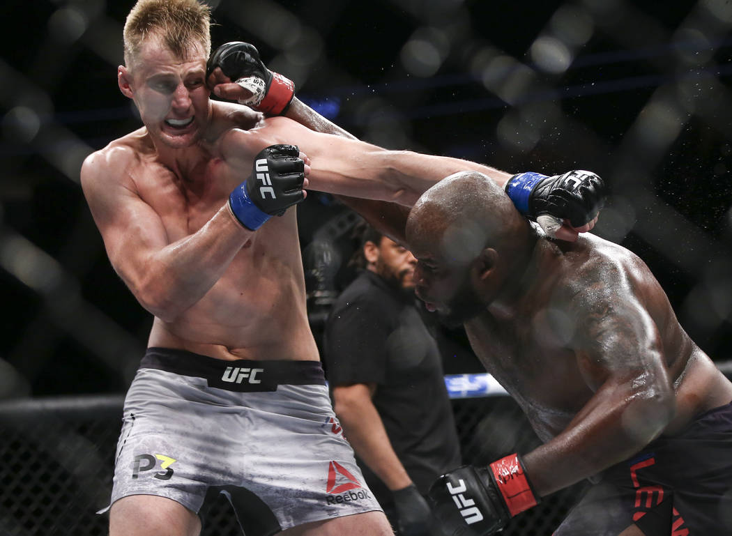 Derrick Lewis, right, lands a hit against Alexander Volkov during their heavyweight bout at UFC 229 at T-Mobile Arena in Las Vegas on Saturday, Oct. 6, 2018. Chase Stevens Las Vegas Review-Journal ...