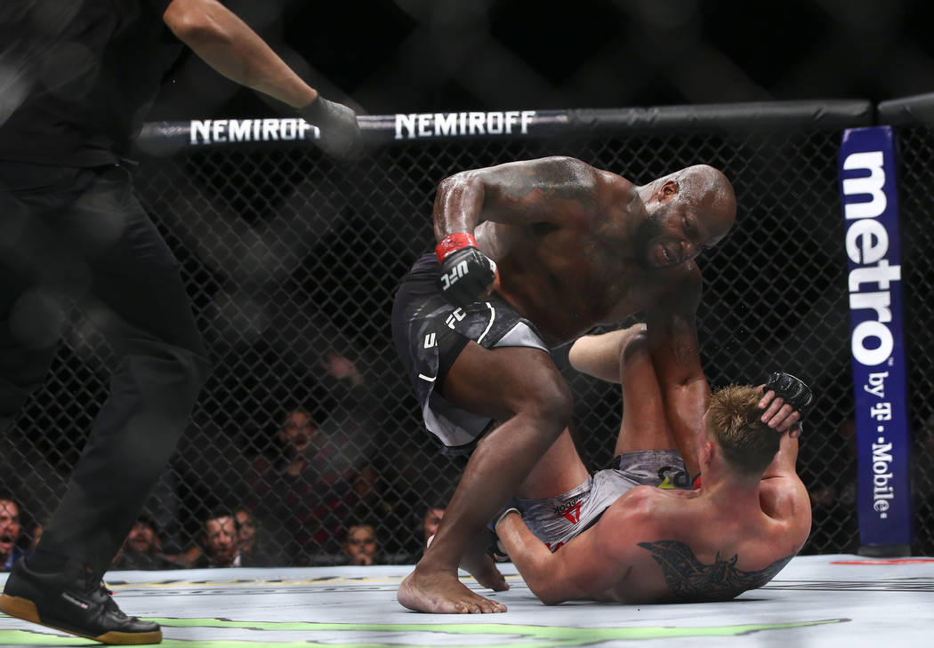 Derrick Lewis, left, delivers a flurry of blows on the way to his knockout win over Alexander Volkov in their heavyweight bout at UFC 229 at T-Mobile Arena in Las Vegas on Saturday, Oct. 6, 2018. ...