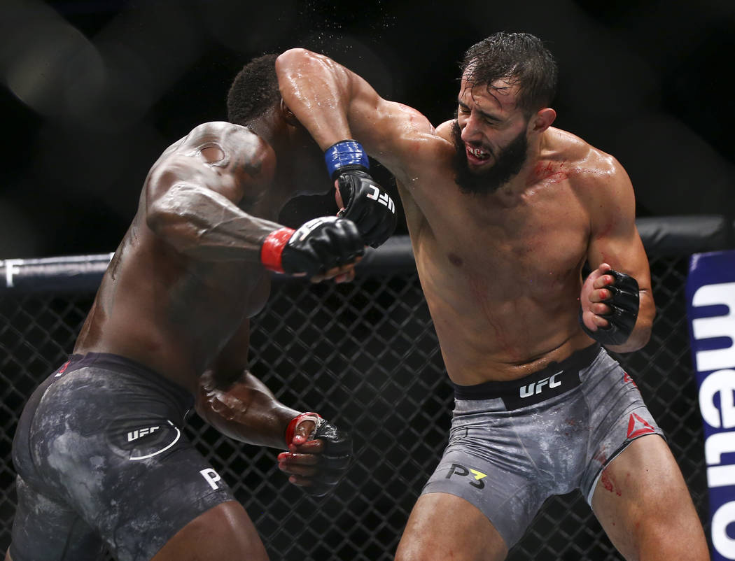 Ovince Saint Preux, left, fights Dominick Reyes during their light heavyweight bout at UFC 229 at T-Mobile Arena in Las Vegas on Saturday, Oct. 6, 2018. Chase Stevens Las Vegas Review-Journal @css ...