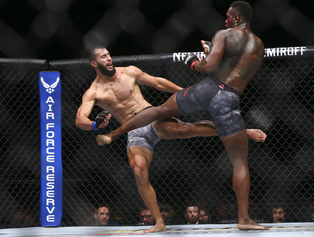 Dominick Reyes, left, takes a kick from Ovince Saint Preux during their light heavyweight bout at UFC 229 at T-Mobile Arena in Las Vegas on Saturday, Oct. 6, 2018. Chase Stevens Las Vegas Review-J ...