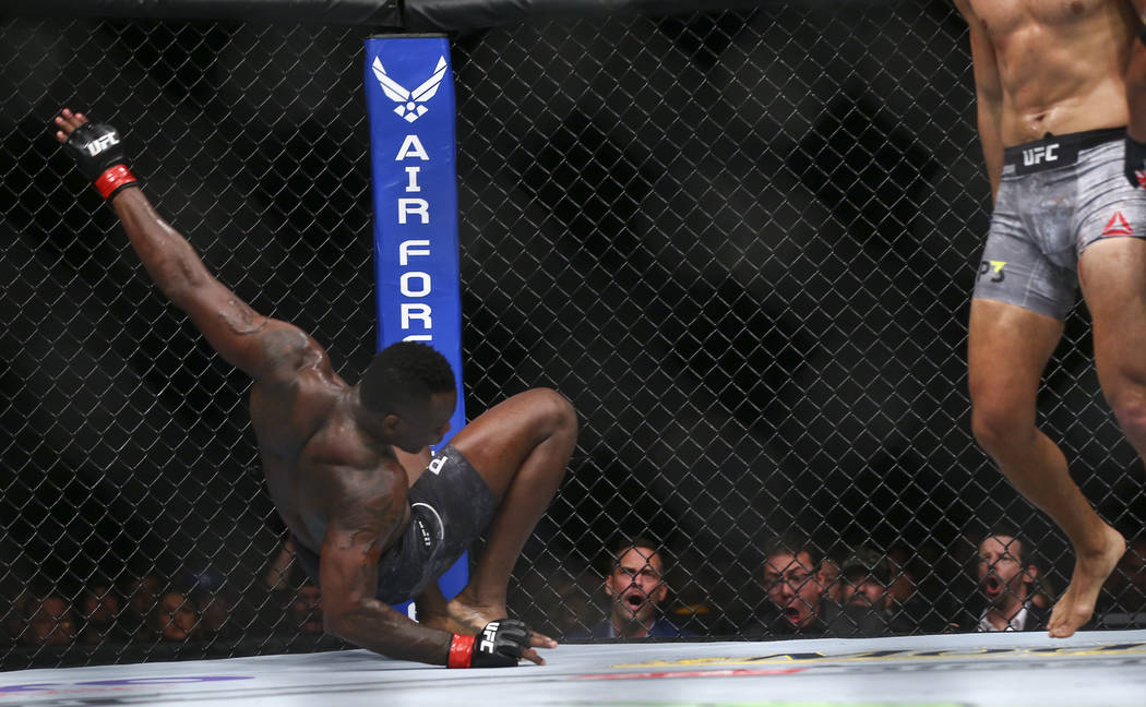 Ovince Saint Preux, left, gets knocked down by Dominick Reyes during their light heavyweight bout at UFC 229 at T-Mobile Arena in Las Vegas on Saturday, Oct. 6, 2018. Chase Stevens Las Vegas Revie ...