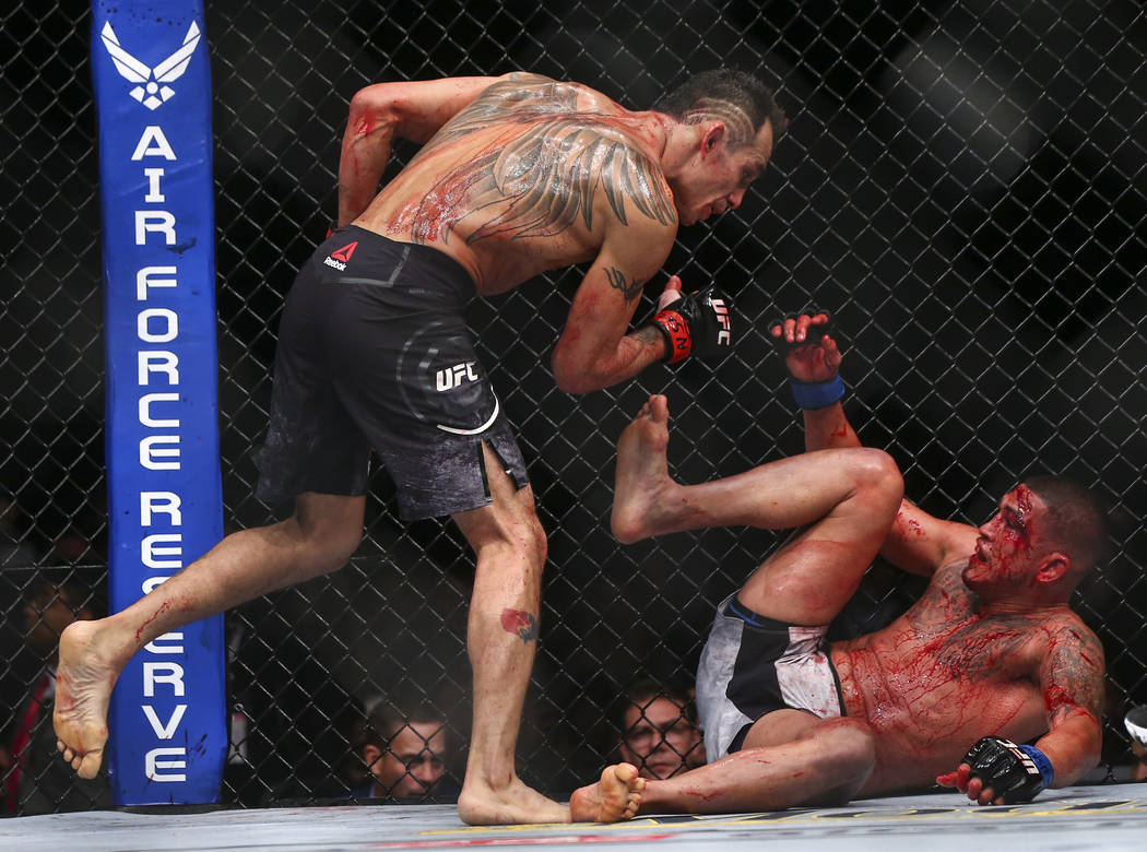 Tony Ferguson, left, fights Anthony Pettis during their lightweight bout at UFC 229 at T-Mobile Arena in Las Vegas on Saturday, Oct. 6, 2018. Chase Stevens Las Vegas Review-Journal @csstevensphoto