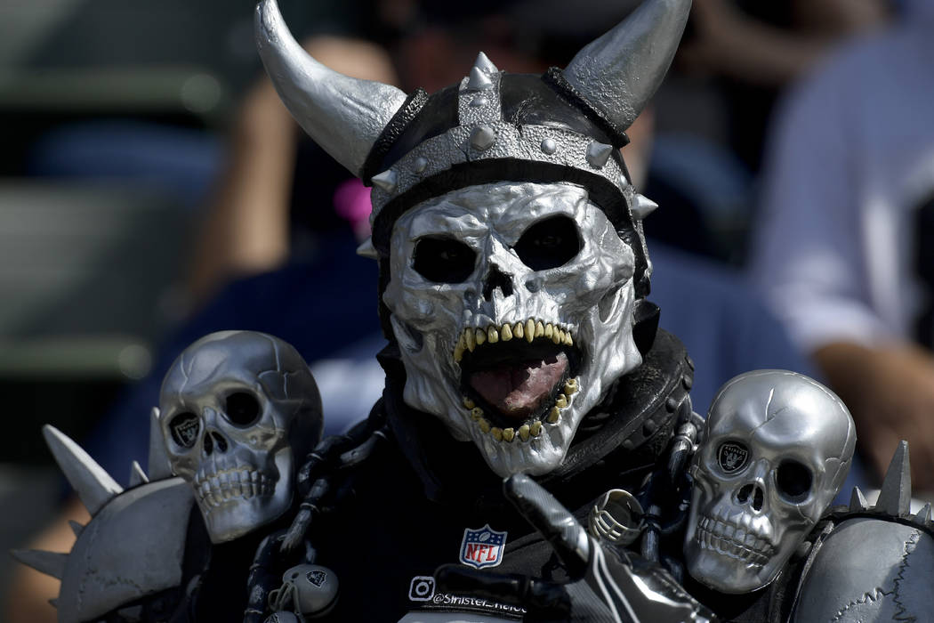 An Oakland Raiders fan looks on before an NFL football game against the Los Angeles Chargers Sunday, Oct. 7, 2018, in Carson, Calif. (AP Photo/Mark J. Terrill)
