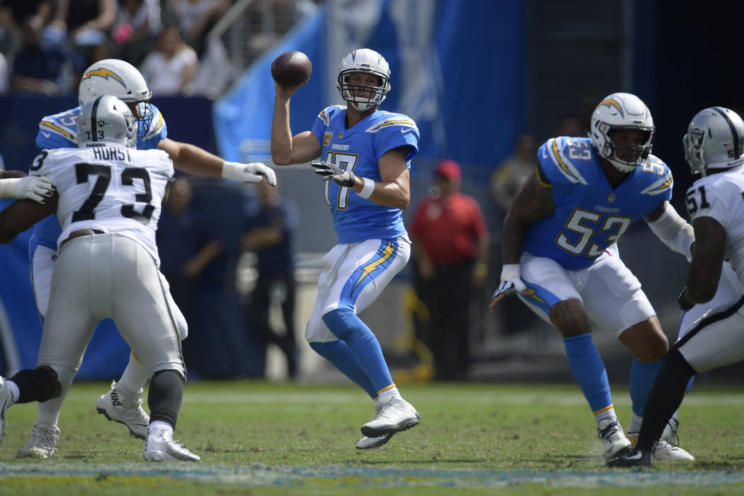 Los Angeles Chargers quarterback Philip Rivers looks to throw a pass during the first half of an NFL football game against the Oakland Raiders Sunday, Oct. 7, 2018, in Carson, Calif. (AP Photo/Mar ...