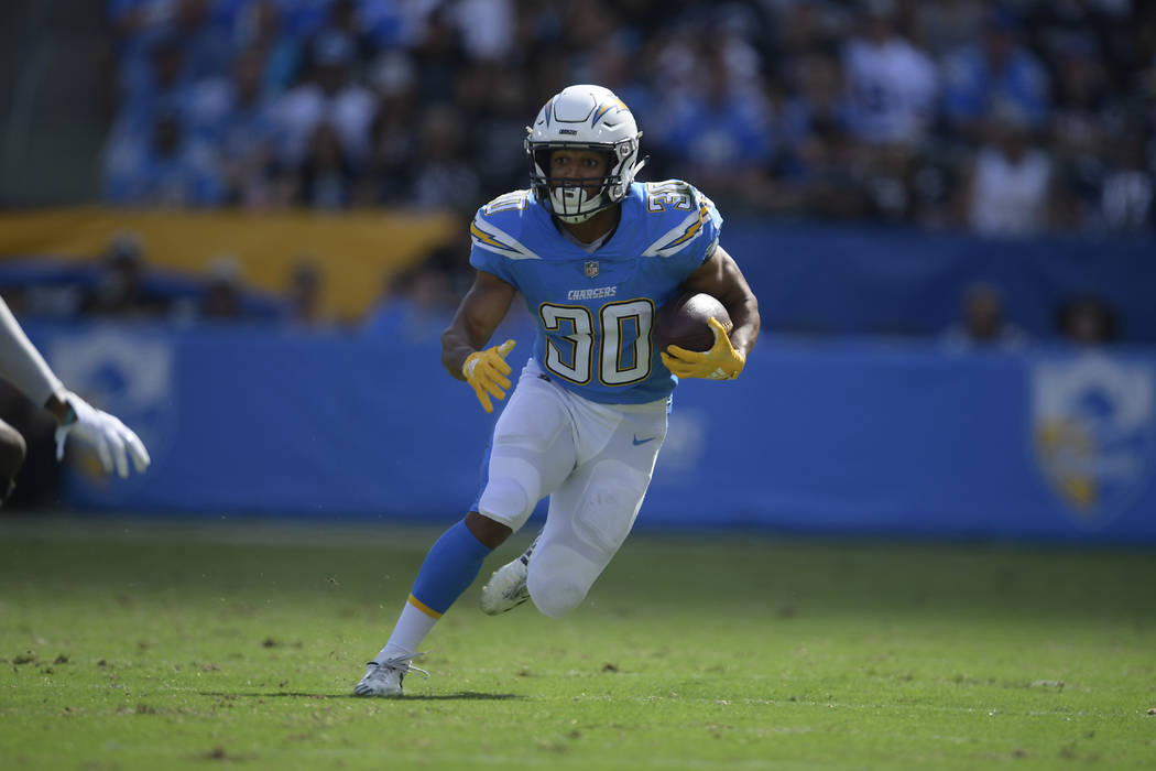 Los Angeles Chargers running back Austin Ekeler runs for a touchdown during the first half of an NFL football game against the Oakland Raiders Sunday, Oct. 7, 2018, in Carson, Calif. (AP Photo/Mar ...
