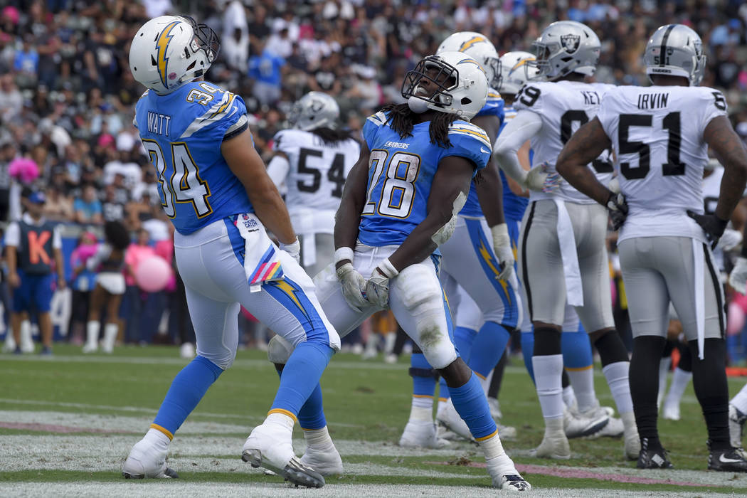 Los Angeles Chargers running back Melvin Gordon (28) celebrates his touchdown with teammate fullback Derek Watt (34) during the first half of an NFL football game against the Oakland Raiders Sunda ...