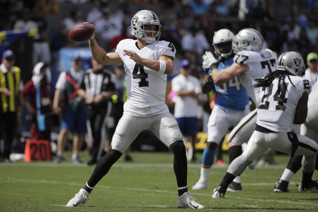 Oakland Raiders quarterback Derek Carr throws a pass during the first half of an NFL football game against the Los Angeles Chargers Sunday, Oct. 7, 2018, in Carson, Calif. (AP Photo/Jae C. Hong)