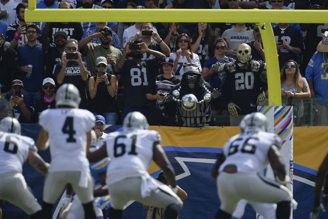 Oakland Raiders fans look on during the first half of an NFL football game against the Los Angeles Chargers Sunday, Oct. 7, 2018, in Carson, Calif. (AP Photo/Mark J. Terrill)