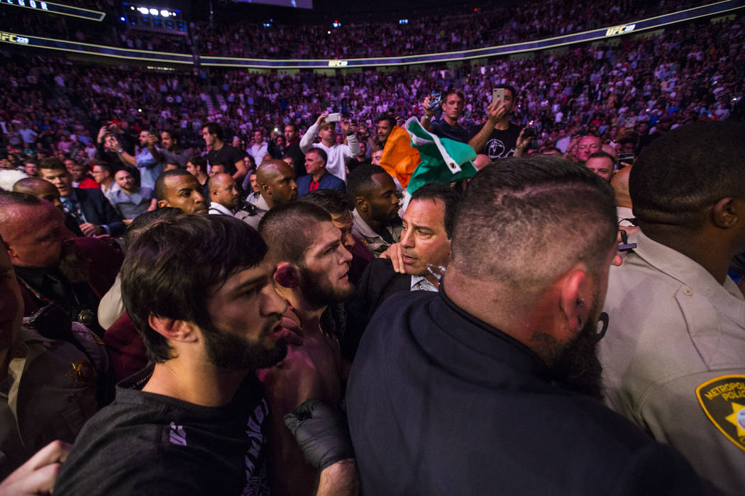 Khabib Nurmagomedov leaves the octagon after his win over Conor McGregor in their lightweight title bout at UFC 229 at T-Mobile Arena in Las Vegas on Saturday, Oct. 6, 2018. Chase Stevens Las Vega ...