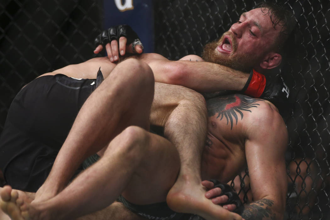 Khabib Nurmagomedov keeps Conor McGregor down on the mat during their lightweight title bout at UFC 229 at T-Mobile Arena in Las Vegas on Saturday, Oct. 6, 2018. Chase Stevens Las Vegas Review-Jou ...