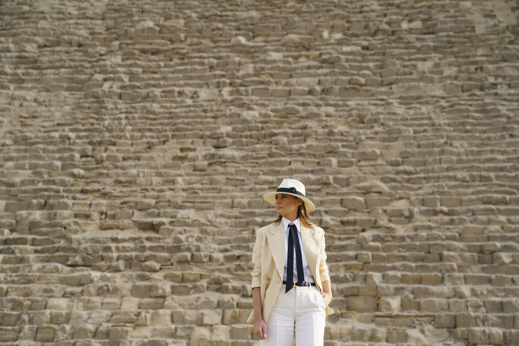 First lady Melania Trump visits the historical site of the Giza Pyramids in Giza, near Cairo, Egypt. Saturday, Oct. 6, 2018. First lady Melania Trump is visiting Africa on her first big solo inter ...