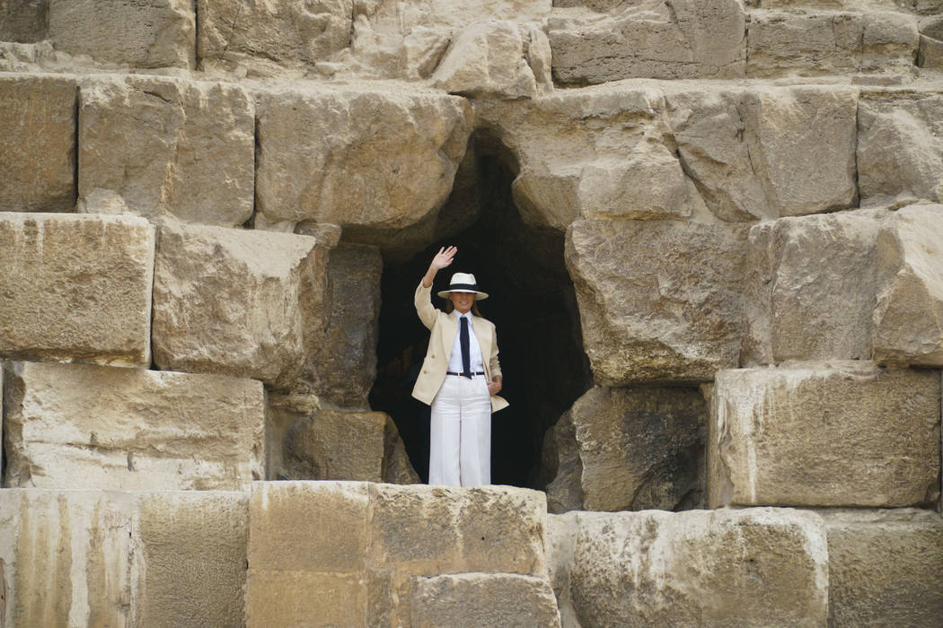 First lady Melania Trump waves before entering the Great Pyramid as she visits the historical site of the Giza Pyramids in Giza, near Cairo, Egypt. Saturday, Oct. 6, 2018. First lady Melania Trump ...