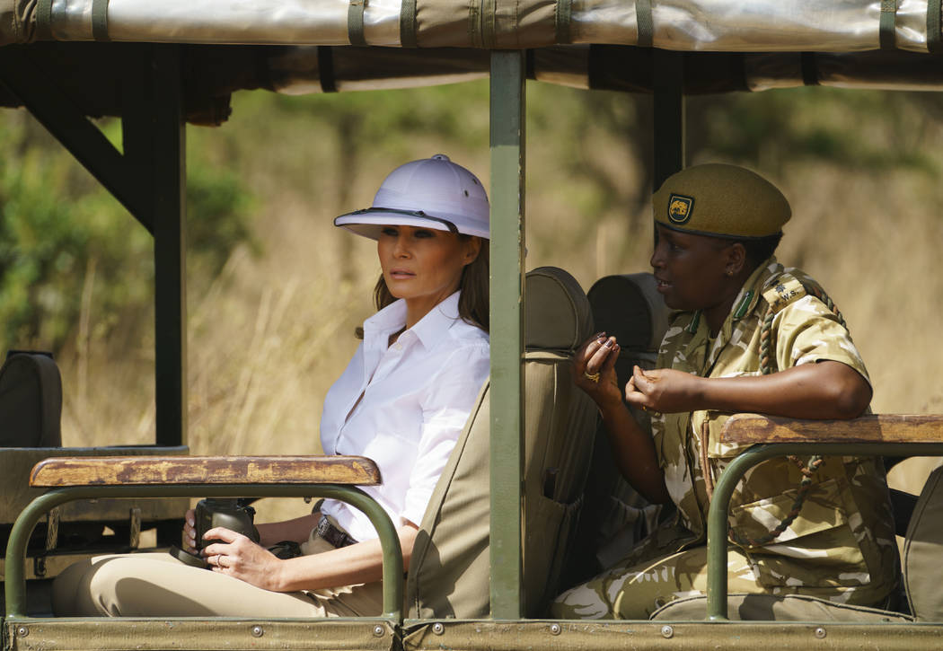 First lady Melania Trump looks out over Nairobi National Park in Nairobi, Kenya, Friday, Oct. 5, 2018, during a safari guided by Nelly Palmeris, right. Mrs. Trump is visiting Africa on her first b ...