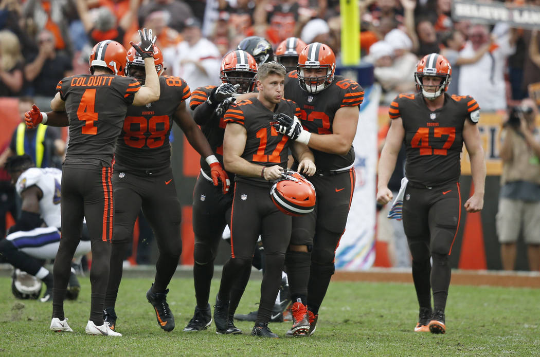 Cleveland Browns kicker Greg Joseph (17) celebrates with teammates after Joseph kicked a game-winning 37-yard field goal during overtime in an NFL football game against the Baltimore Ravens, Sunda ...