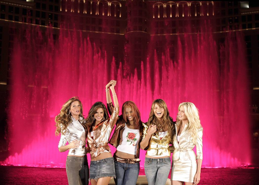 Victoria's Secret models pose in front of the Bellagio fountains during their Angels Across America tour Thursday, Nov. 11, 2004. (John Locher/Las Vegas Review-Journal)
