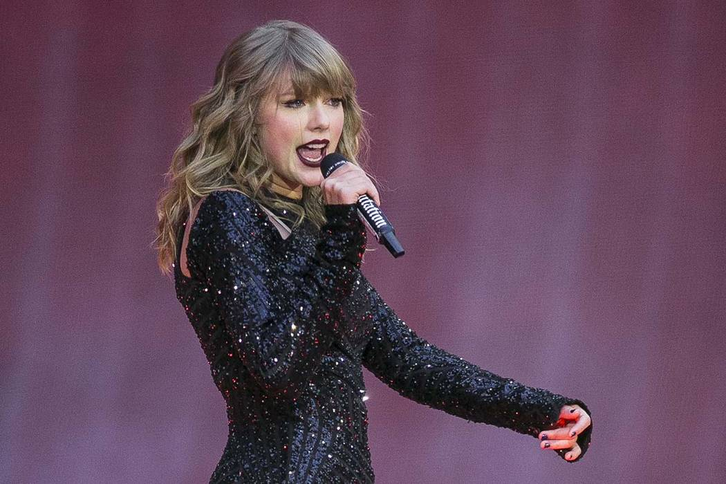 In this June 22, 2018, file photo, singer Taylor Swift performs on stage in concert at Wembley Stadium in London. Swift posted on Instagram Sunday, Oct. 7, that she's voting for Tennessee's Democ ...